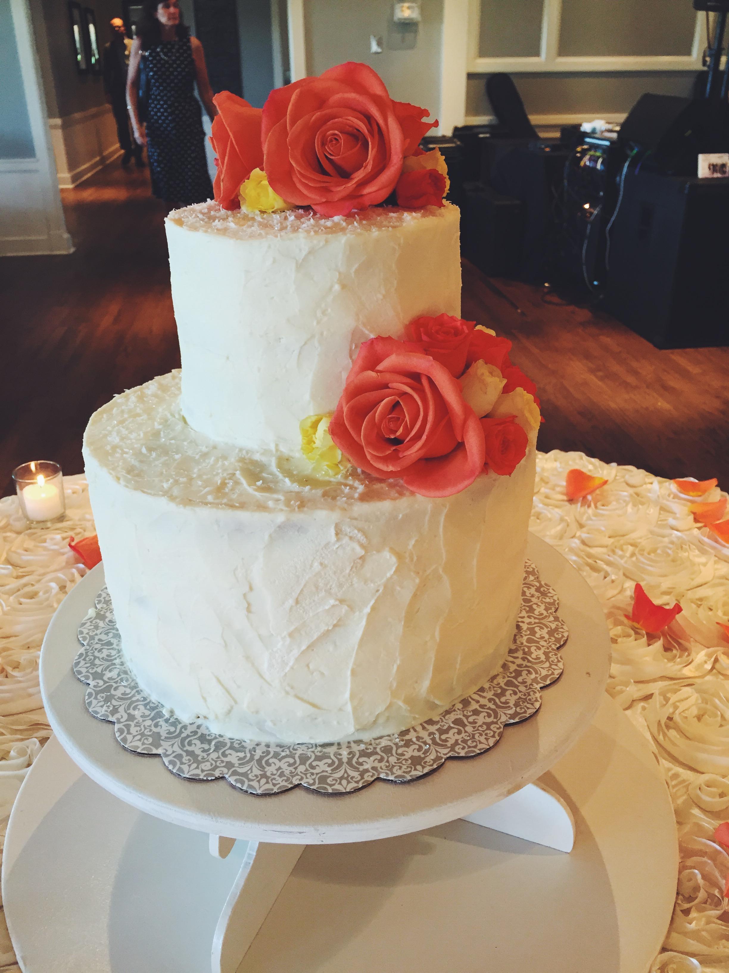 coconut wedding cake with chocolate ganache and coconut